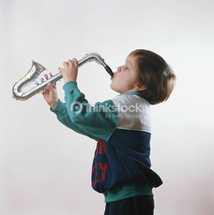 boy-playing-trumpet-side-view-picture-id200325090-001
